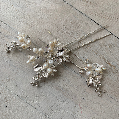 Set of freshwater pearls and silver rhinestone bridal hairpins.